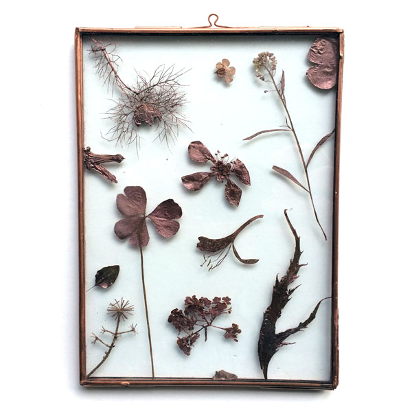 copper frame with painted dried leaves